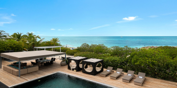Sun loungers by the swimming pool at Villa Bella Vita, Babalua Beach, Providenciales (Provo), Turks and Caicos Islands.