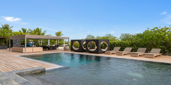 This fully staffed Turks and Caicos luxury villa rental has a spacious pool deck.