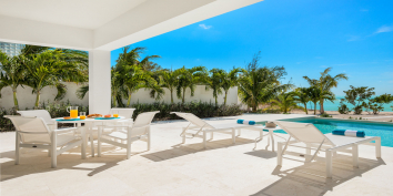 The pool terrace of Villa Bari has space for relaxing and dining.