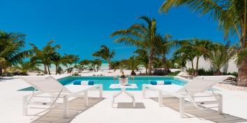 Relax and soak up the tropical sunshine at Villa Sardinia, Taylor Bay Beach, Turks and Caicos Islands.
