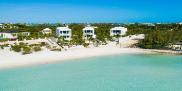Villa Sardinia (in the middle) is one of a trio of contemporary, one-bedroom villas right on beautiful Taylor Bay Beach, Provo, Turks and Caicos Islands.