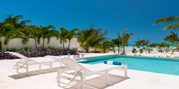 The pool terrace of Villa Sardinia has space for relaxing and dining.