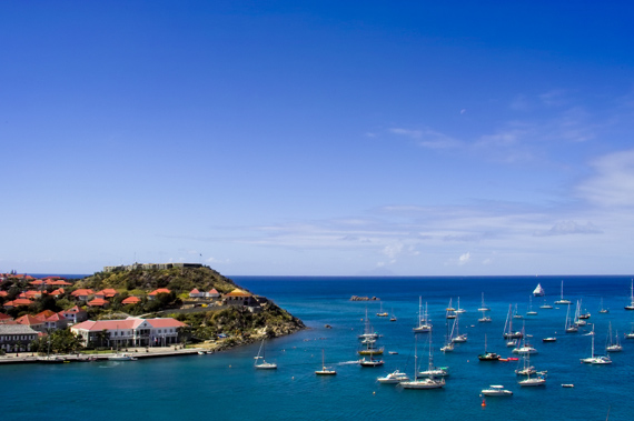 Sailing yachts anchored off beautiful St. Barts (Saint Barths) in the Caribbean.