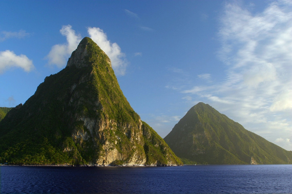 The magnificent twin peaks of the Pitons rise almost half a mile above sea level on St. Lucia in the Caribbean.