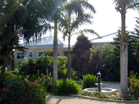 The beautiful, tropical gardens of Three Dolphins Villa, Long Bay Beach, Providenciales (Provo), Turks and Caicos Islands